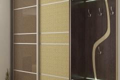 Шкаф купе в прихожую Одна раздвижная дверь со вс тавками из стекла шоколадного цвета Другая раздвижная дверь со вставками из ротанга Угловые, стеклянные, подсвеченные полки